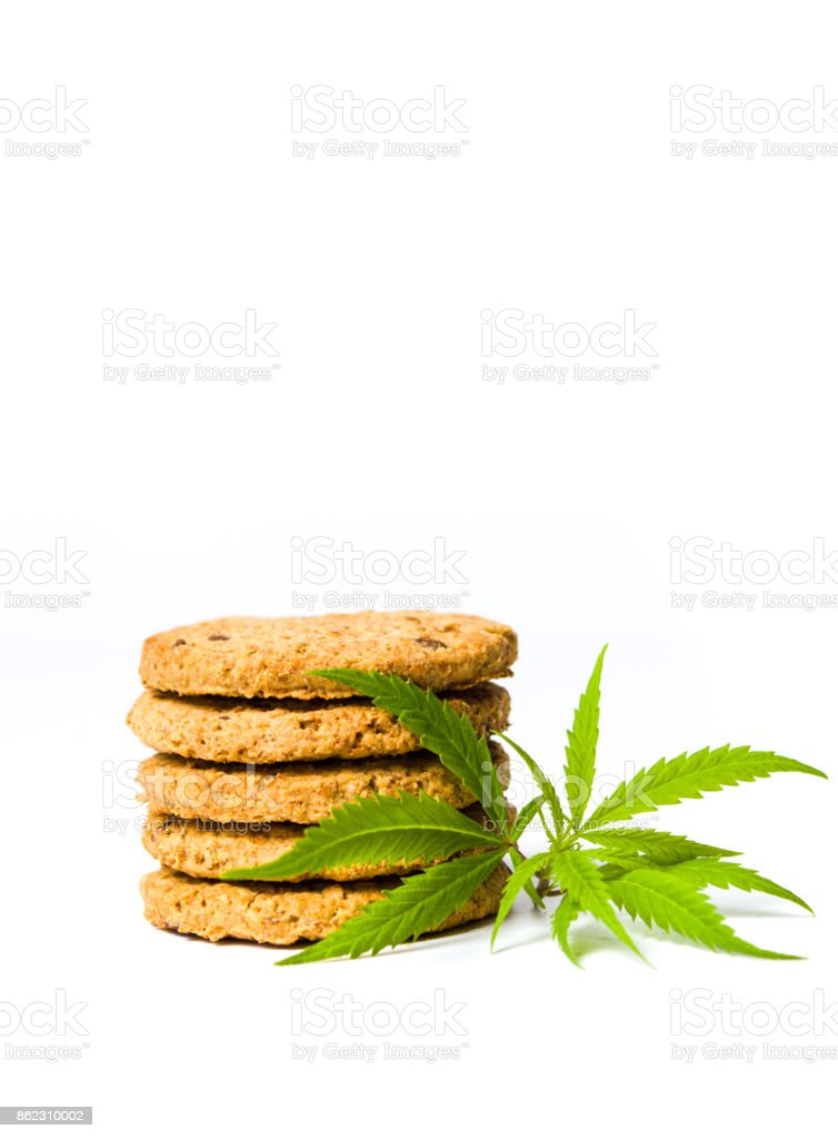 Integral cookies with marijuana leafs isolated stock photo