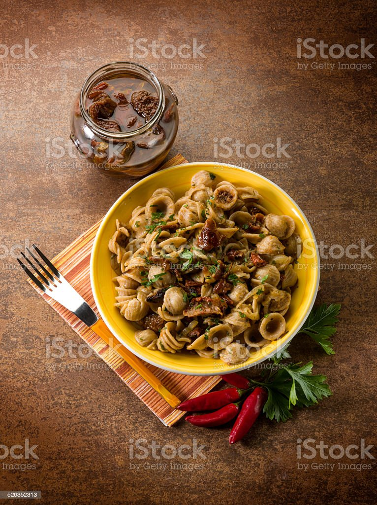 integral orecchiette with dried tomatoes stock photo