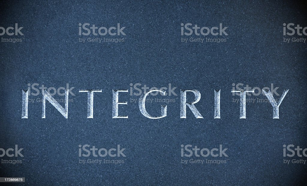 Integrity carved on a blue marble stone royalty-free stock photo