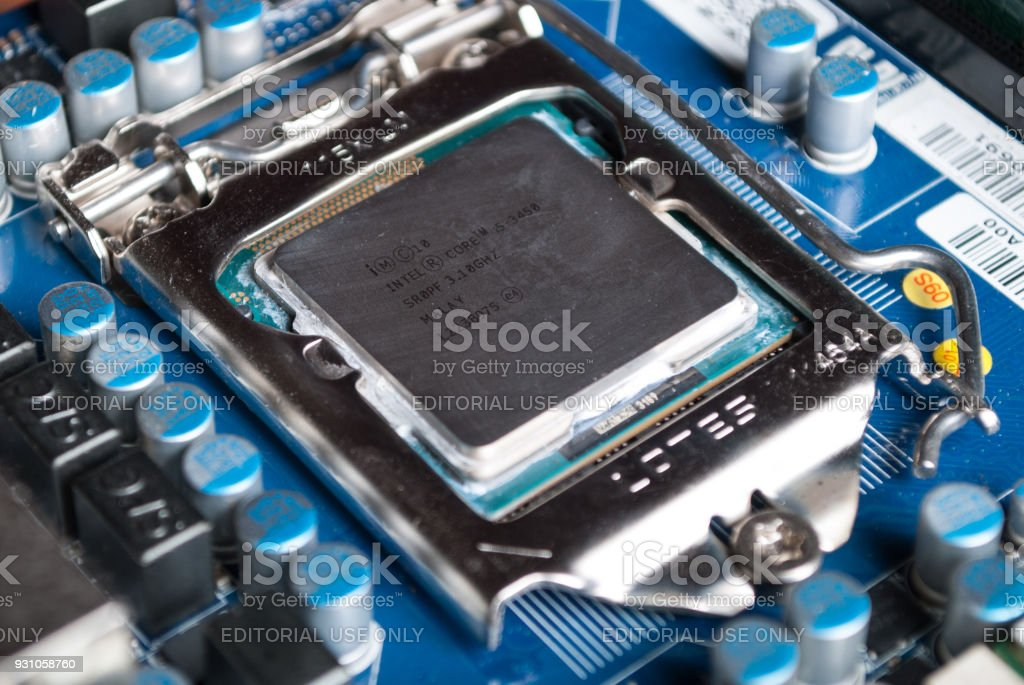 CPU Intel i5 on computer motherboard in socket stock photo