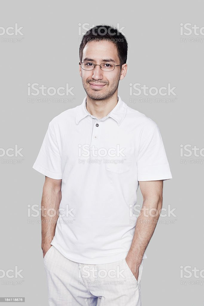 Intellectual latino man with hands in pocket stock photo