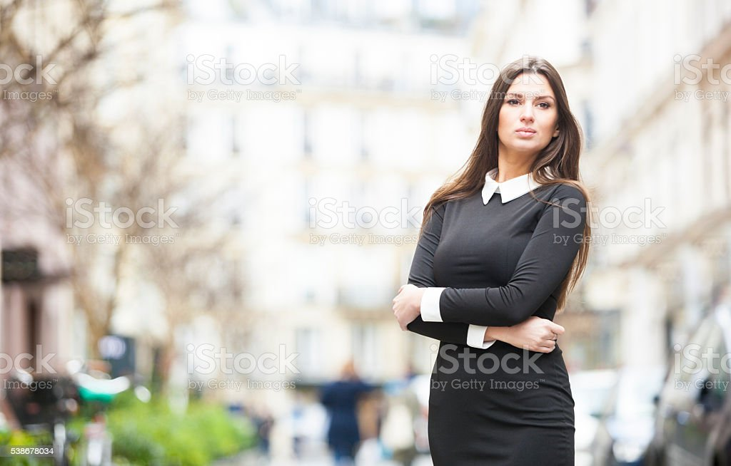 Intelligent and Attractive Woman's Portrait In A City Street stock photo