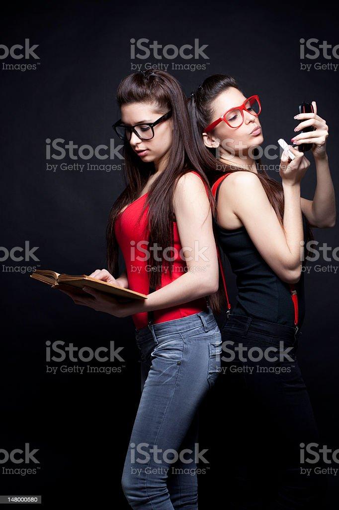 Intelligent And Beautiful Twins royalty-free stock photo
