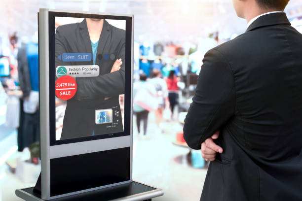 Intelligent Digital Signage , Augmented reality marketing and face recognition concept. Smart glass interactive artificial intelligence digital advertisement in fashion retail shopping Mall. stock photo