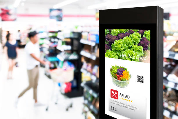 Intelligent Digital Signage , Augmented reality marketing and face recognition concept. Interactive artificial intelligence digital advertisement in retail hypermarket Mall. stock photo
