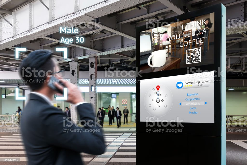 Intelligent Digital Signage , Augmented reality marketing and face recognition concept. Interactive artificial intelligence digital advertisement navigator direction for retail coffee shop. stock photo