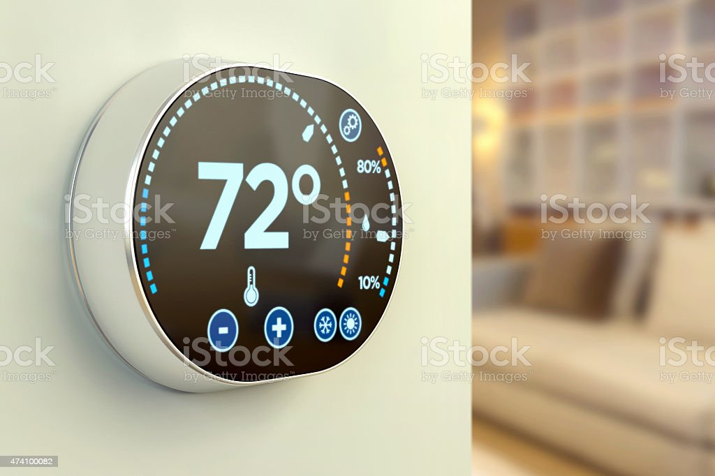 Intelligent home automation system: Fahrenheit temperature multimedia thermostat royalty-free stock photo
