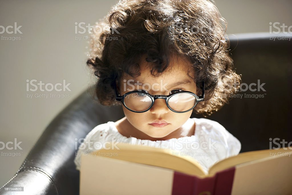 Intelligent little bookworm stock photo