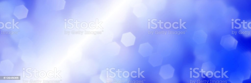 intense bokeh background in shades of blue and white stock photo