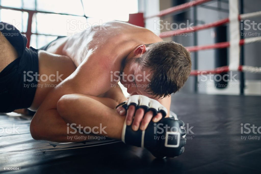 Intense Floor Tackle in Mix Fighting stock photo