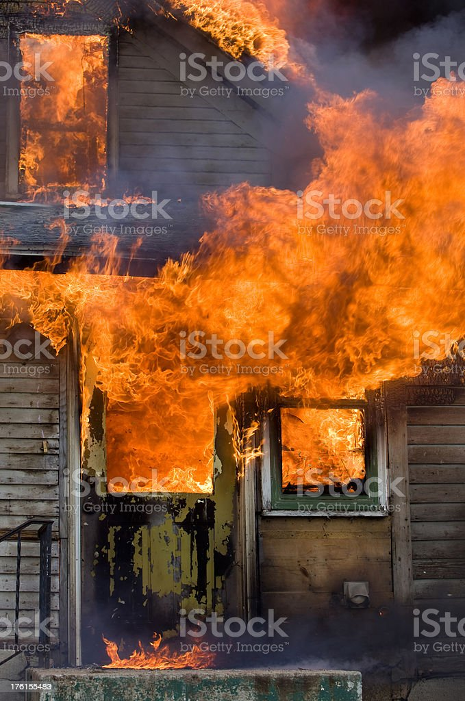 Intense House Fire with Flames and Smoke royalty-free stock photo