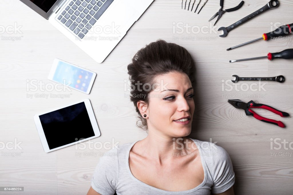 intense look of a woman with digital problems stock photo