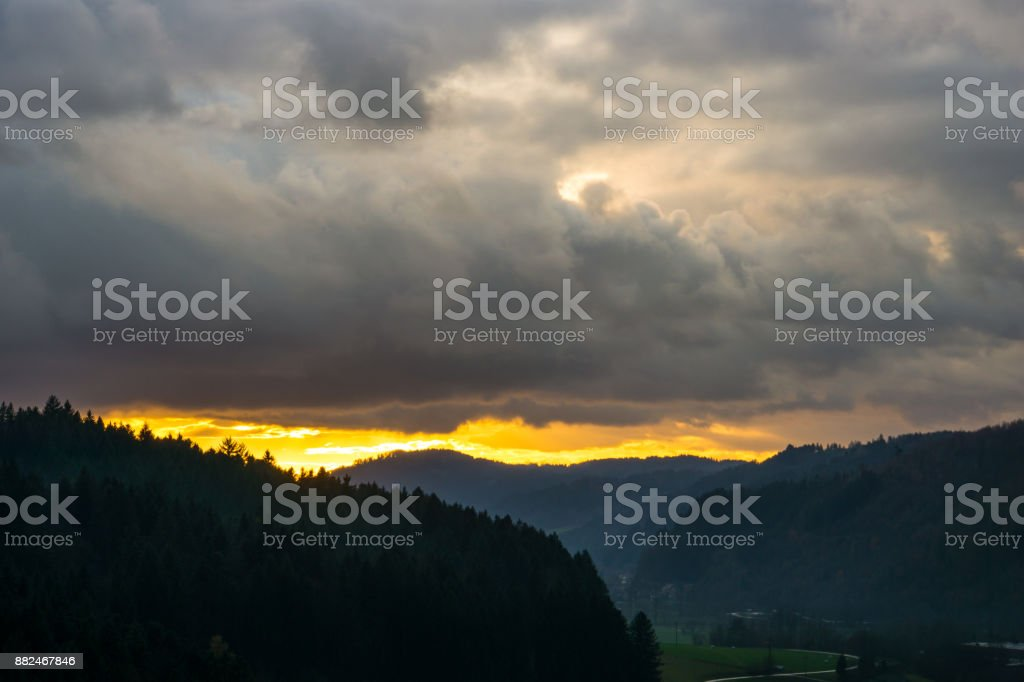 Intense orange sunset in the middle of the black forest near Freiburg...