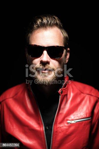 542972720 istock photo Intense portrait of a bearded man 864452264