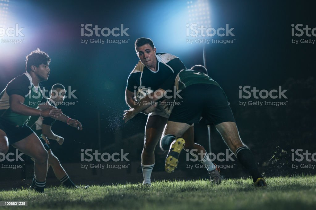 Intense rugby action at sports arena stock photo