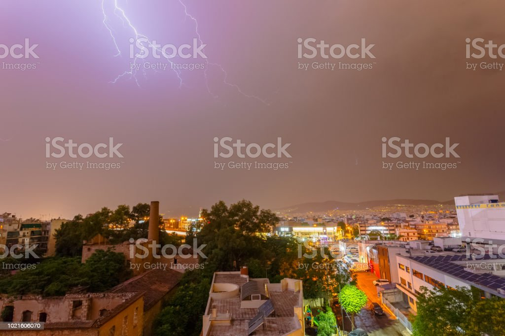 Intense stormy weather night with lightning bolts and thunderbolts...