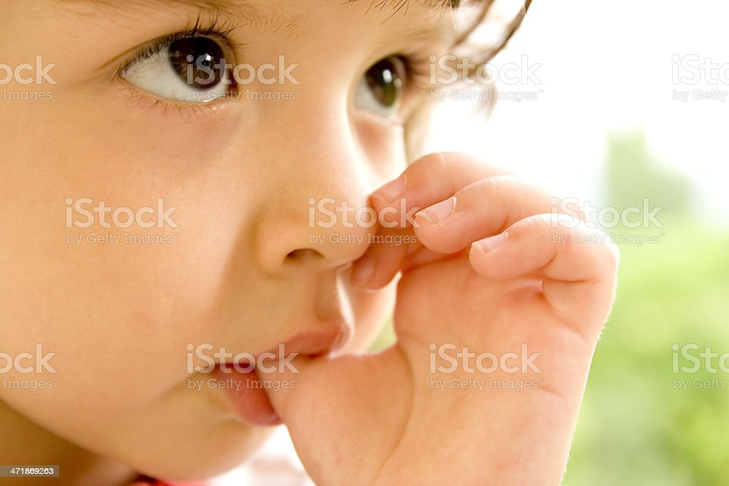 Intense thumb sucking girl stock photo