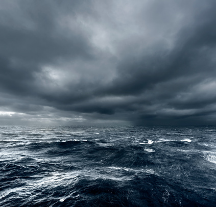 Intense thunderstorm rolling over open ocean