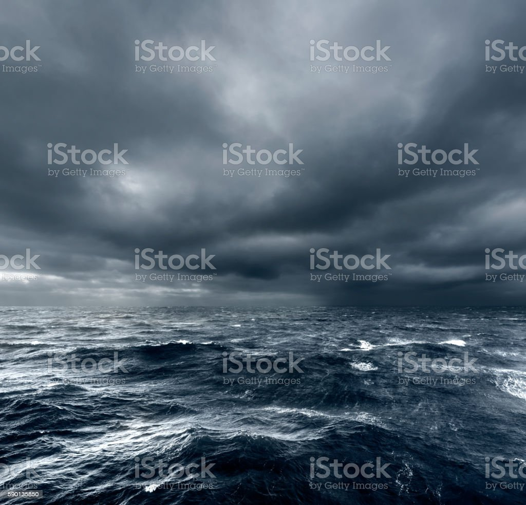 Intense thunderstorm rolling over open ocean stock photo