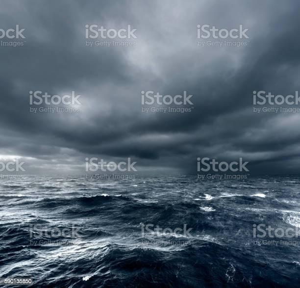 Photo of Intense thunderstorm rolling over open ocean