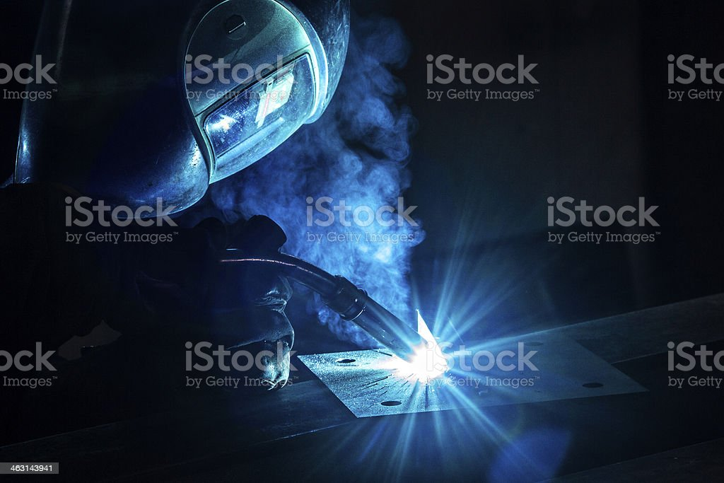 Intense welding of a metal producing light effects  stock photo