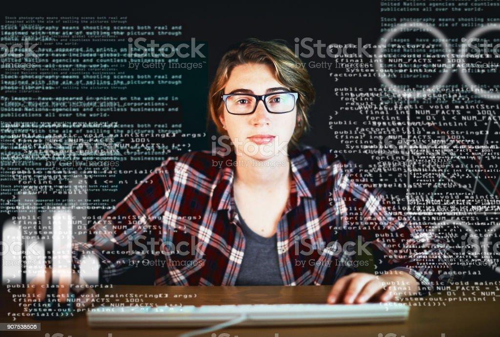 Intense young woman stares through interactive screen at camera stock photo