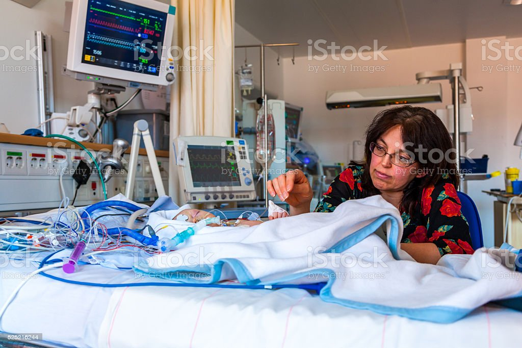 Intensive care mother and child. stock photo