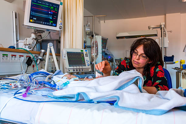 intensive care mother and child. - mom spying stock photos and pictures