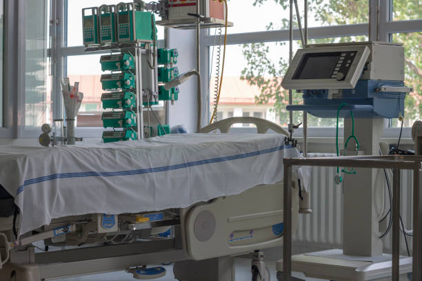 Intensive care unit in hospital, bed with monitor, ventilator, a place where can be  treated patients with pneumonia caused by coronavirus covid 19. stock photo