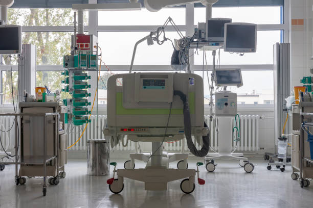 Intensive care unit in hospital, bed with monitors, ventilator, a place where can be  treated patients with pneumonia caused by coronavirus covid 19. stock photo