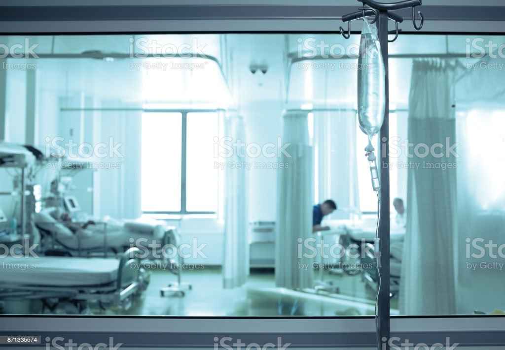 Intensive care unit ward behind the window glass stock photo