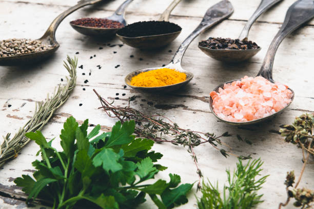 Intensive condiments on old spoons spices on wooden table alternative medicine stock pictures, royalty-free photos & images
