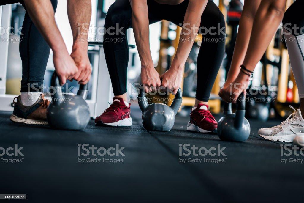 Intensive gym training, low angle, copy space. - Zbiór zdjęć royalty-free (Aktywny tryb życia)