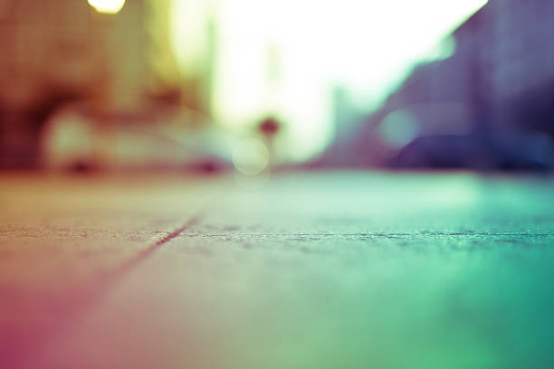intentionally blurred colorful filtered view of a concrete sidew - generic location stock pictures, royalty-free photos & images
