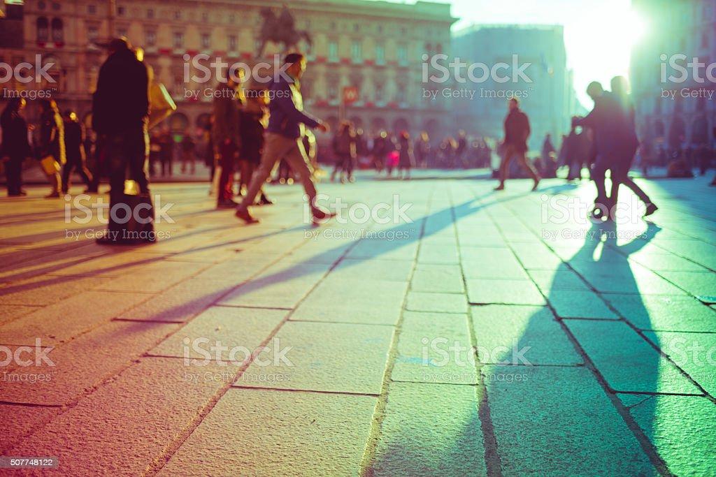 Intentionally blurred filtered vintage of defocused people walking stock photo