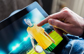 Interaction with soccer player on a digital tablet