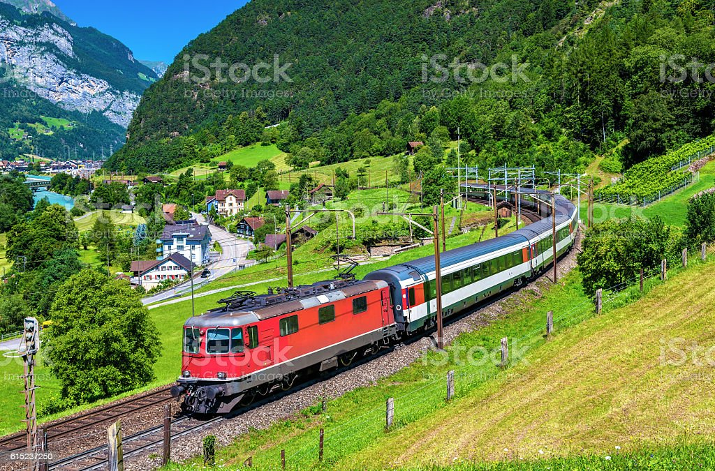 Intercity train climbs up the Gotthard railway - Switzerland stock photo