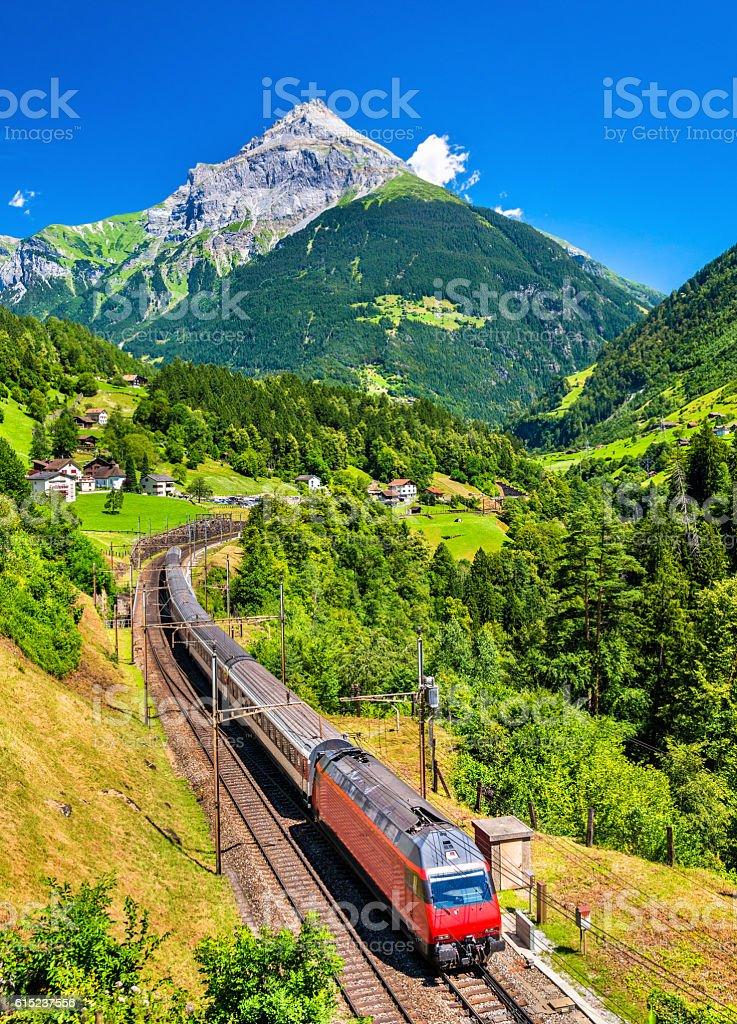 Intercity train climbs up the Gotthard railway - Switzerland stock photo