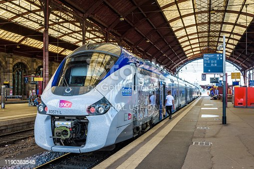 Strasbourg, France - September 16, 2019: A Regiolis TER regional train from french company SNCF is stationing at the platform in the SNCF train station waiting for passengers to get on.