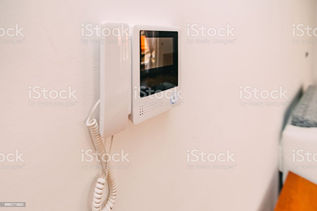Intercom in the apartment. Intercom hanging on the wall. Interco stock photo