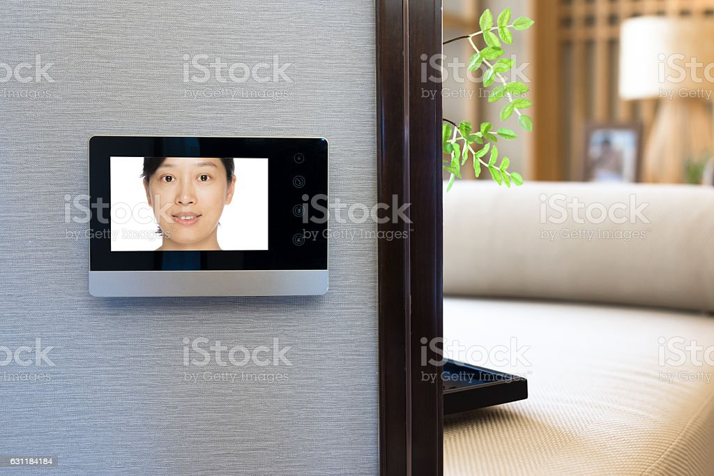 intercom video door bell on the wall outside modern bedroom stock photo