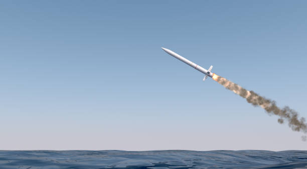 Intercontinental Ballistic Missile An intercontinental ballistic missile launching across the ocean on a blue sky backgrund - 3D render military attack stock pictures, royalty-free photos & images