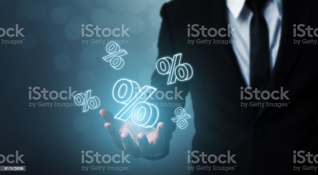 Interest rate financial and mortgage rates concept. Businessman hand show icon percent 3d sign stock photo
