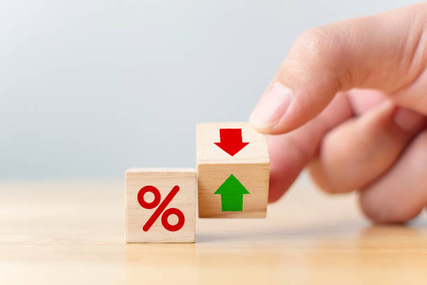 Interest rate financial and mortgage rates concept. Hand flip wood cube change arrow down to up Interest rate financial and mortgage rates concept. Hand flip wood cube change arrow down to up cheap stock pictures, royalty-free photos & images