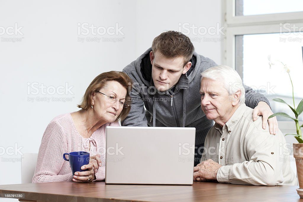 interested seniors in a computer lesson royalty-free stock photo