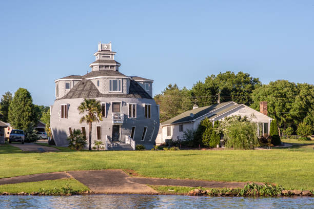 Interesting architecture in upstate S.C. Inman, S.C. / USA - May 2019: An interesting spherical, round home located on Lake Bowen in upstate, South Carolina, in Spartanburg county. spartanburg stock pictures, royalty-free photos & images