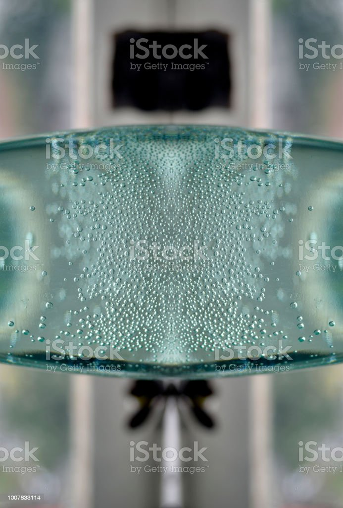 Image montage, made of parts of plastic bottle full with fresh water