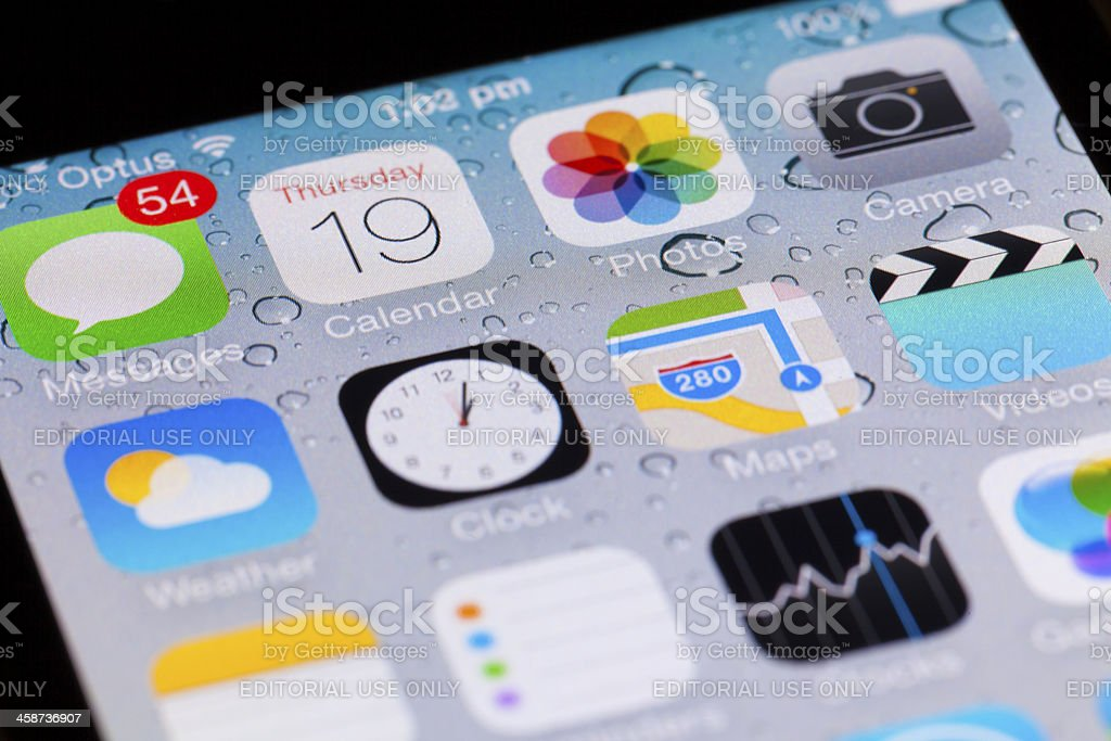 Interface of iOS 7 on an iPhone 4 stock photo