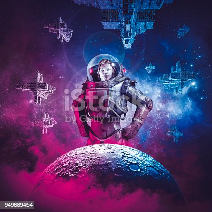istock Intergalactic female space hero 949889454