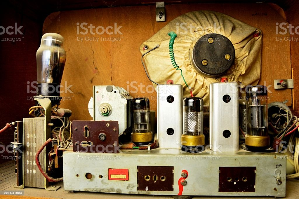 Interior and circuits of vintage tube Czechoslovak radio from Cold War era, covered with dust stock photo